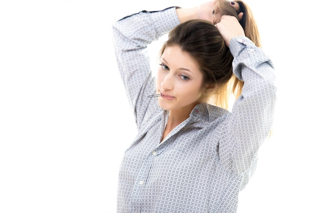 Young woman putting her hair up