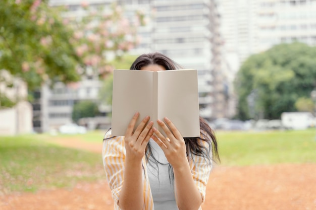 Young woman reading an interesting book