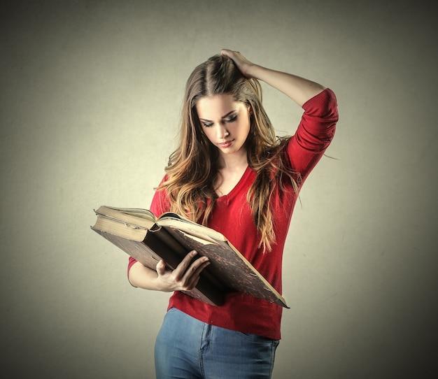 Young woman reading a kodex
