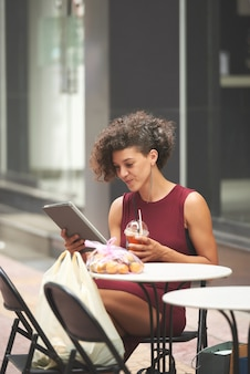 Young woman reading news article
