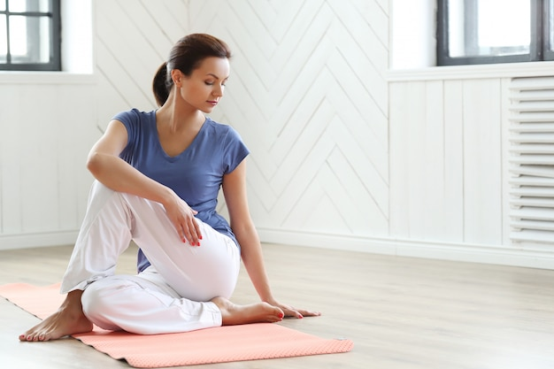 Young woman ready to do yoga exercises