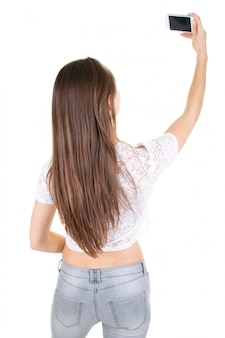 Young woman in rear back view taking a selfie