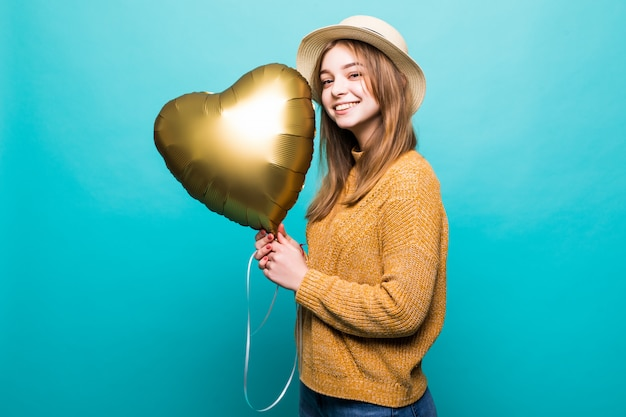 Young woman receive air baloon on anniversary celebration isolated over color wall