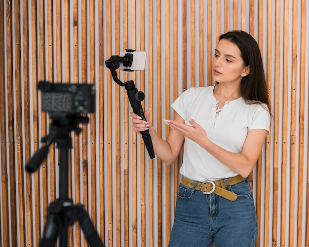 Young woman recording a video