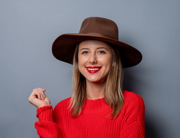 Young woman in red sweater and hat