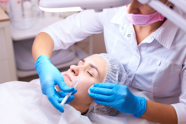 Young woman on rejuvenation procedure in a cosmetology clinic