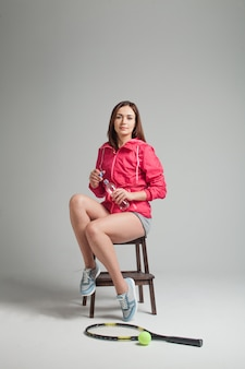 Young woman relaxing after tennis training