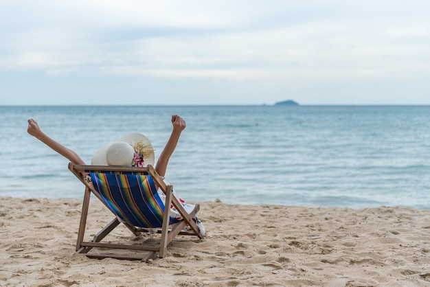 Young woman relaxing on the beach chair, summer vacation holidays trip.