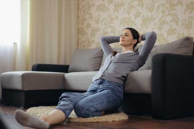 Young woman relaxing in the living room watching the tv