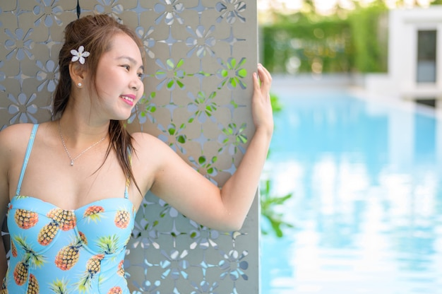Young woman relaxing at the pool travel concept