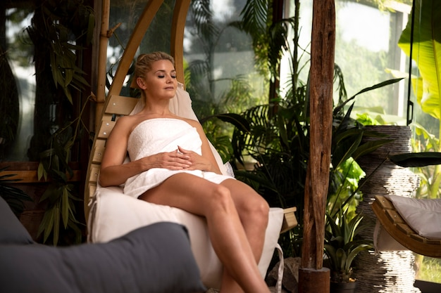 Young woman relaxing at a spa hotel outdoors