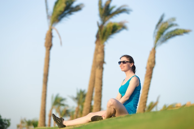 Young woman relaxing in sunlight after fitness workout