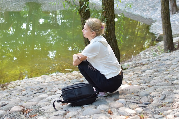 Young woman resting in the summer park in nature. enjoyment and relaxation in the fresh air.