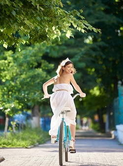 Young woman riding bicycle on the city streets