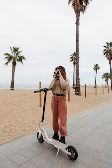 Young woman riding an electric scooter