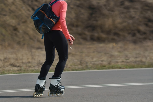 Young woman on roller skates in good weather.