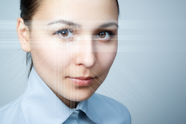 The young woman 's eye is close-up. the concept of the new technology is iris recognition.