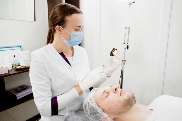 Young woman's getting her skin prepared for face cleaning from acne. solving some age-related skin problems and making it soft and healthy.
