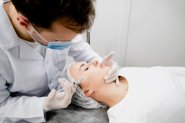 Young woman's getting injections to solve some age-related skin problems and making it soft and healthy.
