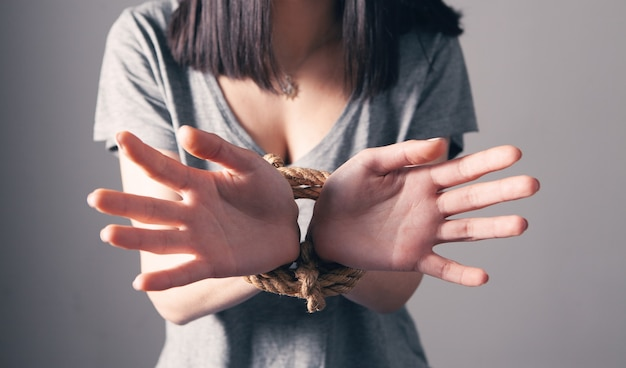 Young woman's hands are tied Premium Photo