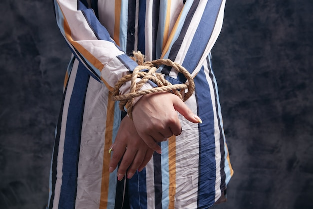 Young woman's hands are tied