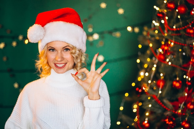Young woman in santa hat on christmas
