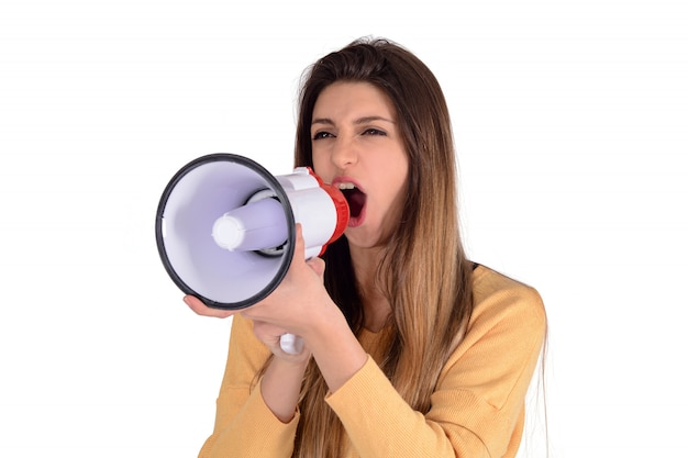 Young woman screaming on a megaphone.
