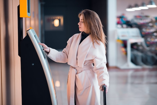 Young woman at self service transfer area.