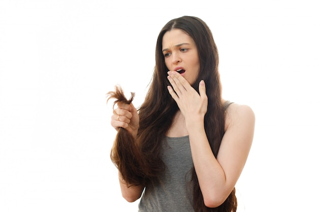 Young woman shocked by split hair problem