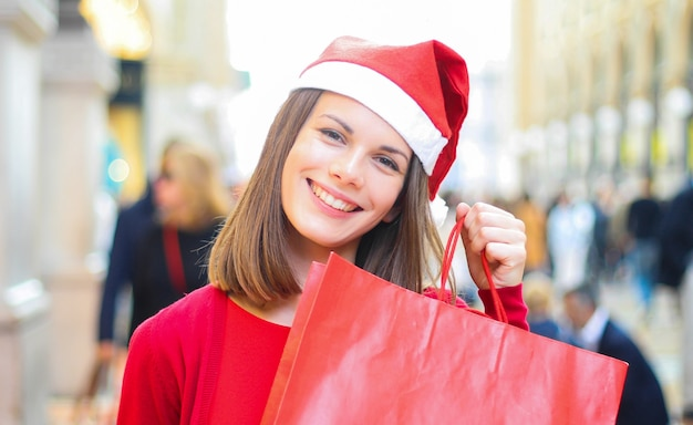Young woman shopping with a christmas outfit