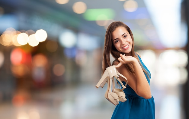 Young woman shopping with high heels in the shopping center