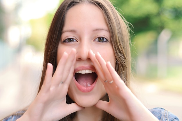 Young woman shouting and screaming.