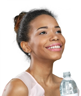 Young woman showing a bottle of water