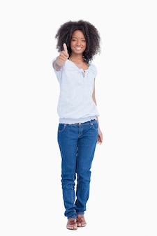 Young woman showing a great smile while placing her thumbs up
