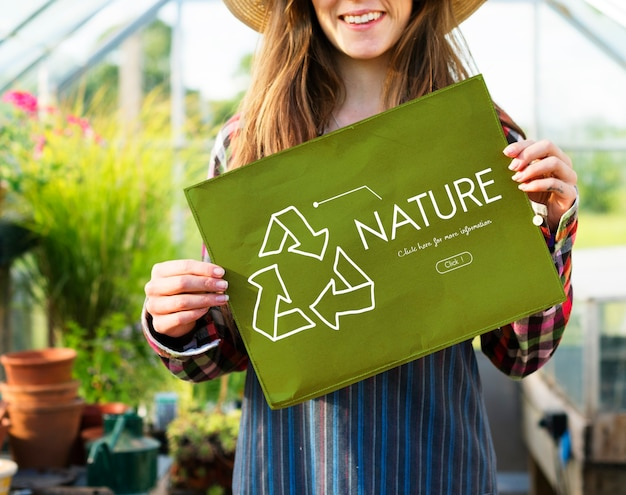 Young woman showing nature poster