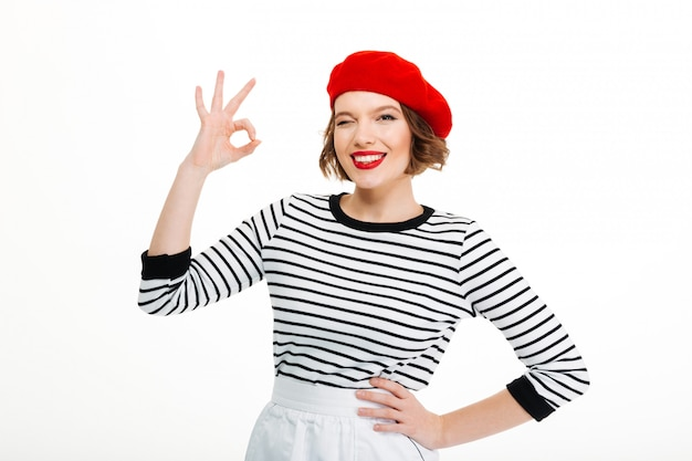 Young woman showing okay gesture.