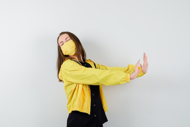 Young woman showing restriction gesture