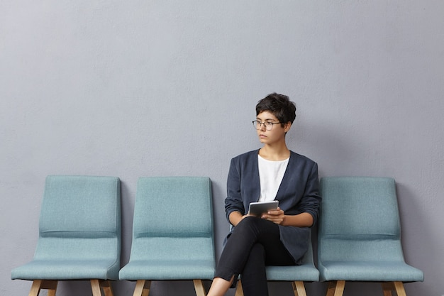 Young woman sitting in waiting room