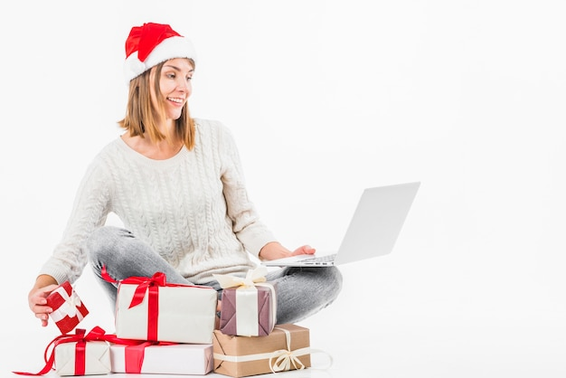 Young woman sitting with laptop on floor