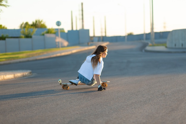 Young woman skating on a sunny day
