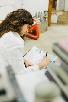 Young woman sketching at home