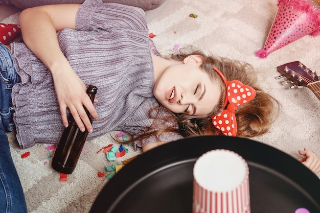 Young woman sleeping after party at home