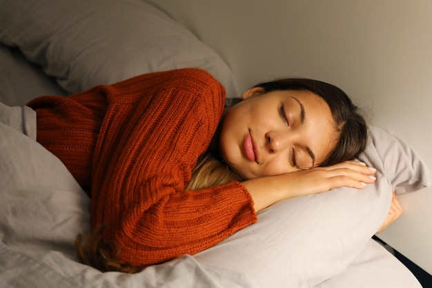 Young woman sleeping peacefully on the bed