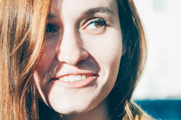 Young woman smiling closeup portrait high key