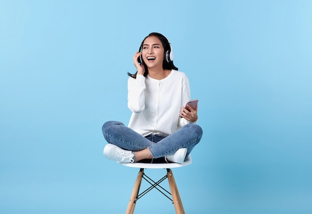 Young woman smiling and wearing wireless headphones
