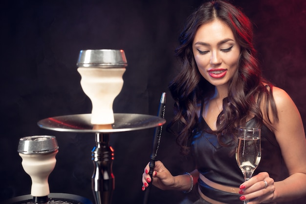 Young woman smoking a hookah