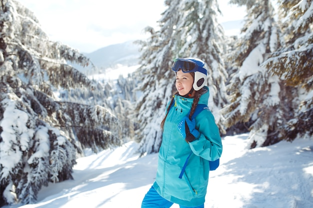 Young woman on the snowy mountains