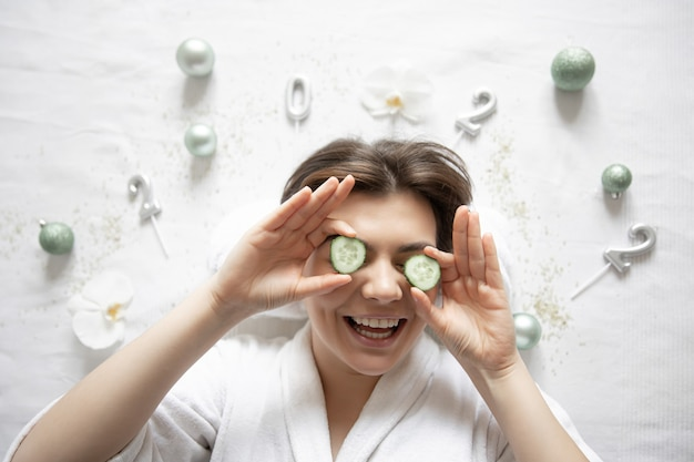 Young woman in spa salon top view christmas festive concept