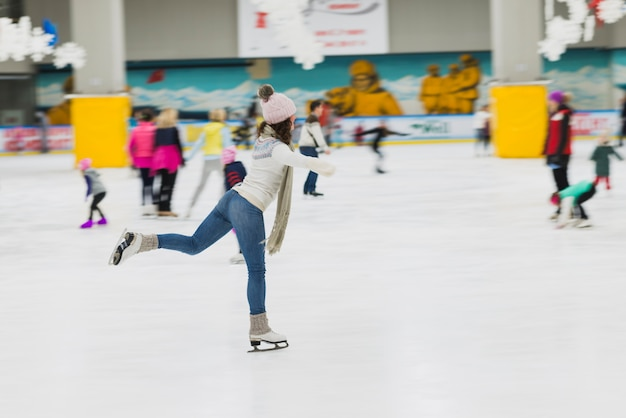 Young woman spending time on skating rink