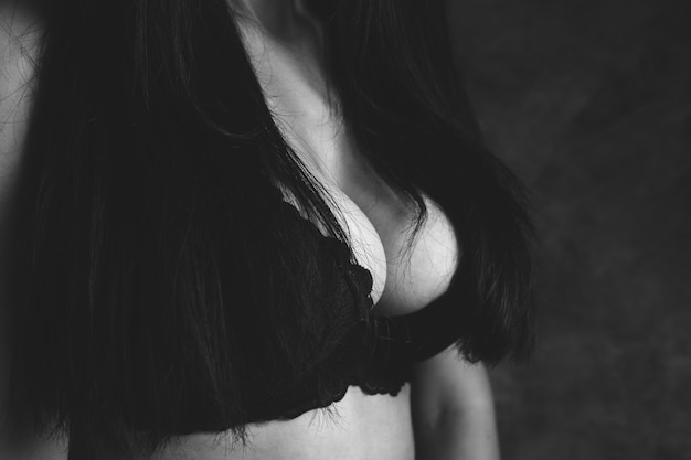Young woman stands in bras
